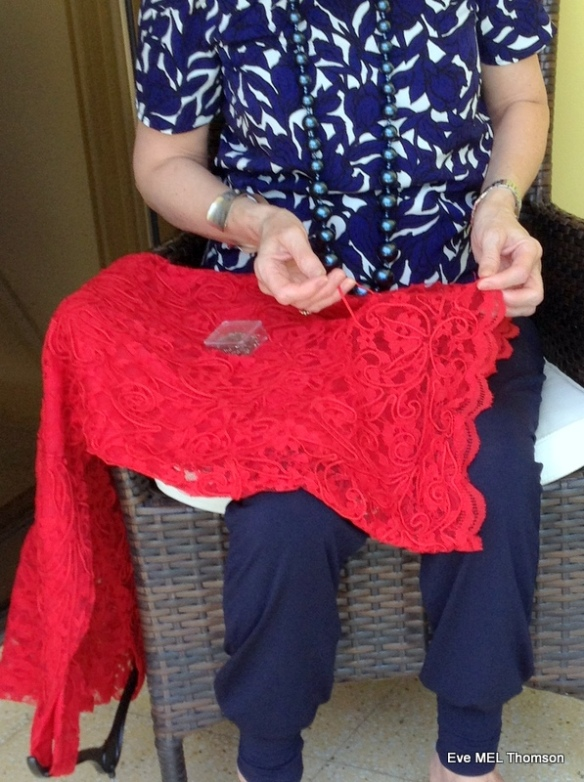 Repairing a red lace dress