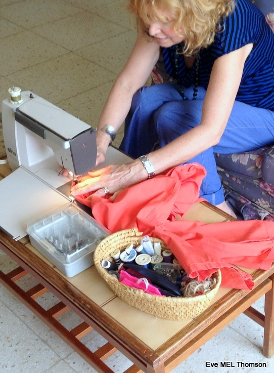 Khaki thread to repair an orange item.