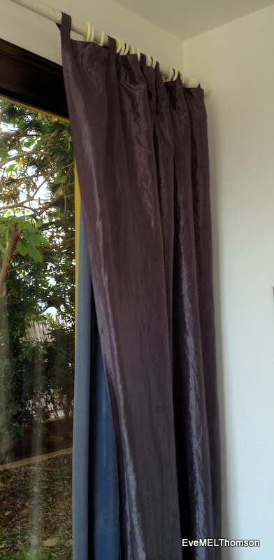 The new grey light-weight curtain hangs over the old blue lined curtain.
