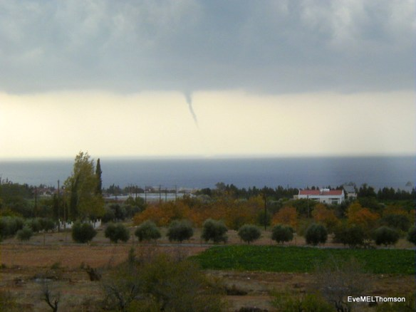 A waterspout approaching land