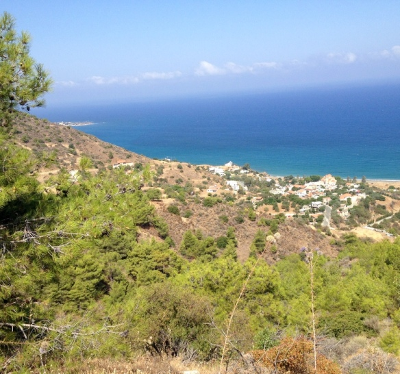 The town of Pomos below